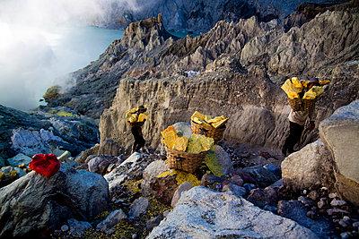 Sulphur miners at the Kawah Ijen Sulphur Mines in East Java - p934m1451347 by Dominic Blewett
