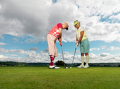Mature ladies learning to playing golf - p4296147 by Colin Hawkins