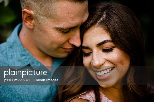 Close Up of Husband & Wife Embracing in San Diego - p1166m2292780 by Cavan Images