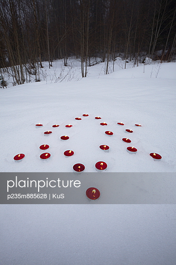 Candles in snow - p235m885628 by KuS