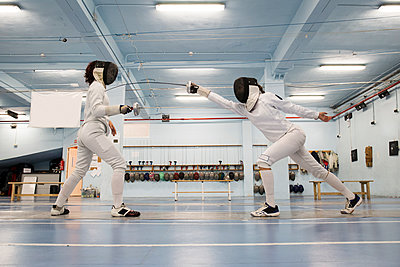 Female fencers during a fencing match - p300m1205456 by Andrés Benitez