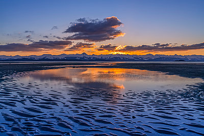 Tidal Flats at low tide at sunset with the Chilkat Mountains in the distance, Eagle Beach State Recreation Area, near Juneau; Alaska, United States of America - p442m2091783 by John Hyde