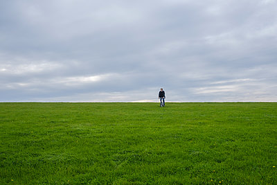 Cyclist on Harlesiel dyke, Germany - p1600m2216242 by Ole Spata