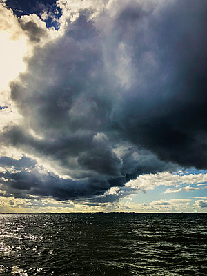 Storm clouds over the Baltic Sea - p382m2284021 by Anna Matzen