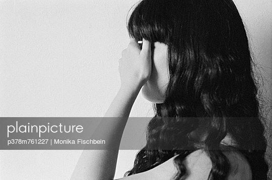 Woman covering eyes - p378m761227 by Monika Fischbein