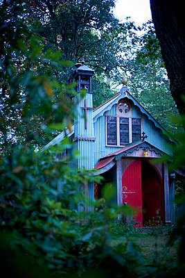 Woodland church viewed through leaves - p349m2167748 by Polly Wreford