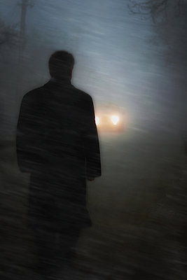 Man  on a street at night - p476m971750 by Ilona Wellmann