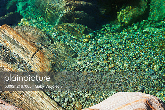 Stones and rocks in clear turquoise waters of Verzasca river, Verzasca Valley, Ticino, Switzerland - p300m2167065 by Gaby Wojciech