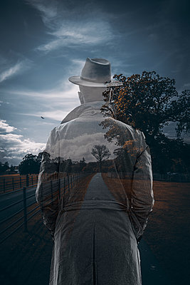 Transparent person in trench coat and hat - p1681m2283655 by Juan Alfonso Solis