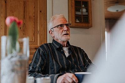 Senior man having coffee - p312m2190974 by Jennifer Nilsson