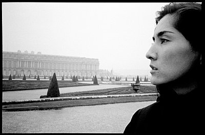"""Close-up profile of woman in the gardens at Versaille, outside of Paris"""" - p3720115 by Tom Maday"""