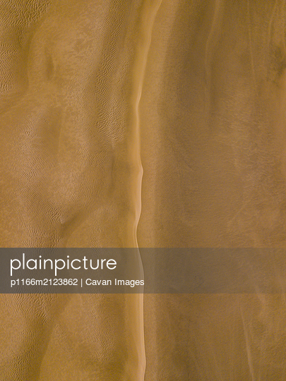 Abstract pattern of sand dunes in Cape Reinga, New Zealand - p1166m2123862 by Cavan Images