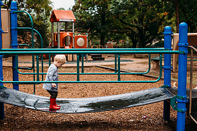 Toddler boy in the playground - p1238m1462496 by Amanda Voelker