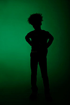 Silhouette from a dark-skinned boy - p249m852175 by Ute Mans