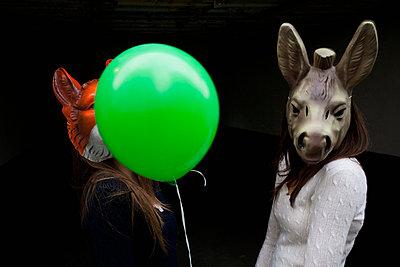 Girls wearing masks - p586m660793 by Kniel Synnatzschke