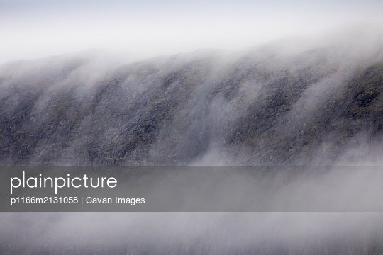 Cloud on top of mountains, Torngats Mountains National Park - p1166m2131058 by Cavan Images