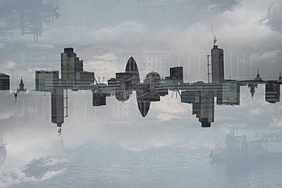 Multiple exposure of cityscape and cloudy sky, London, England, UK - p301m1406536 by Michael Mann