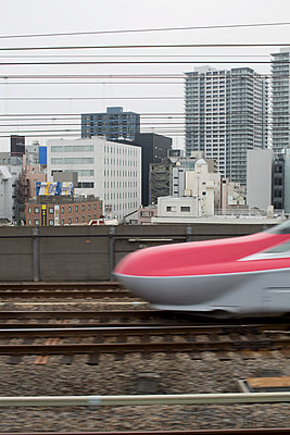 High speed train passing by in Tokyo - p1134m1440626 by Pia Grimbühler
