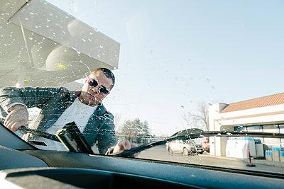 Man Washing Car Window - p1262m1194764 by Maryanne Gobble