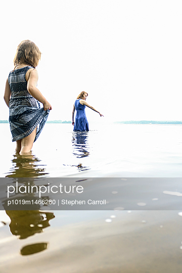 Sisters in river - p1019m1466280 by Stephen Carroll