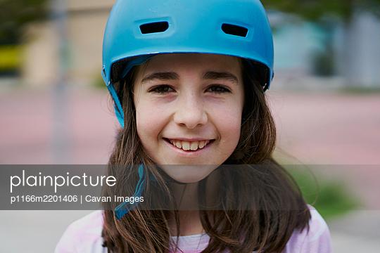 portrait of girl with blue helmet - p1166m2201406 by Cavan Images