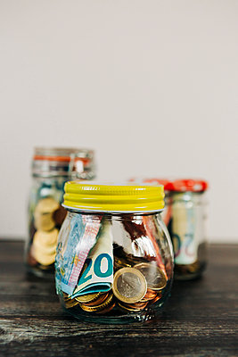 Euro currency in glass jars - p1427m2128259 by Alexandra C. Ribeiro