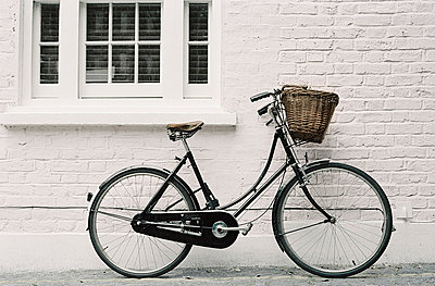Bicycle propped up outside a house - p349m695131 by Emma Lee