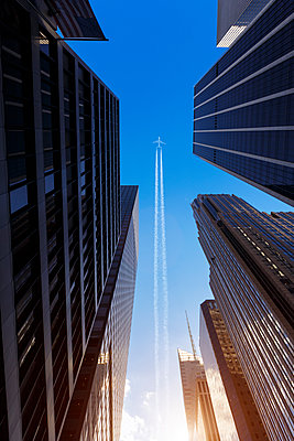 Plane flying over New York - p1280m1574465 by Dave Wall