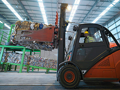 Forklift Truck In Recycle Plant - p4295123f by Monty Rakusen