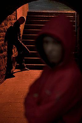 Two boys in a tunnel - p6760129 by Rupert Warren