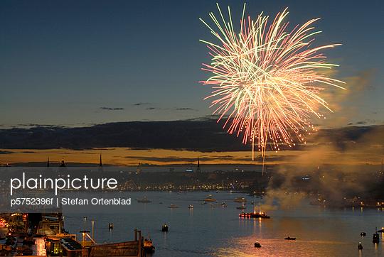 Fireworks over Stockholm Sweden - p5752396f by Stefan Ortenblad