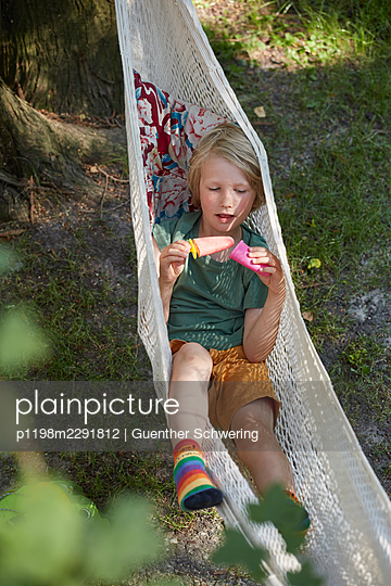 Child in a hammock - p1198m2291812 by Guenther Schwering