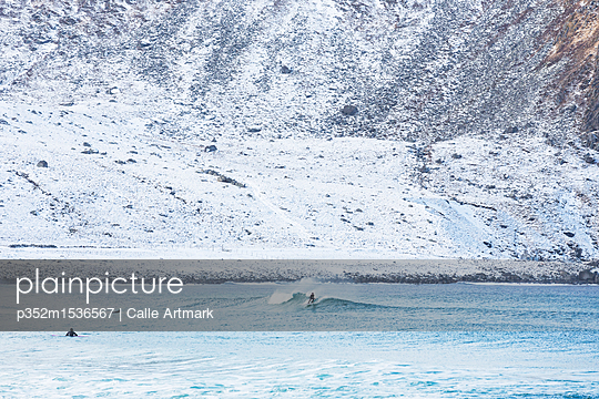 Surfer in Lofoten, Norway - p352m1536567 by Calle Artmark