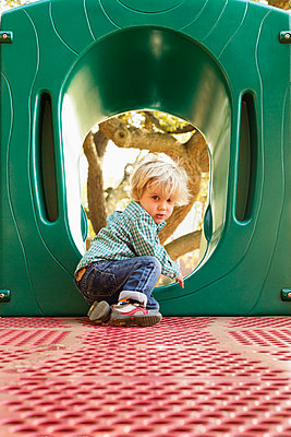 Caucasian boy climbing on play structure in playground - p555m1410890 by Roberto Westbrook