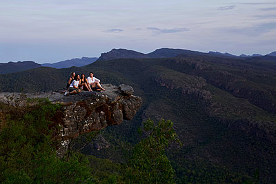 People on a rock ledge - p1399m2065841 by Daniel Hischer