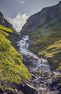 Waterfall in the mountains - p704m1475419 by Daniel Roos