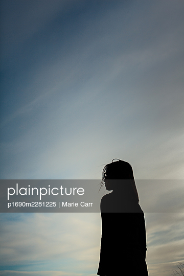 Silhouette of a teenage girl - p1690m2281225 by Marie Carr