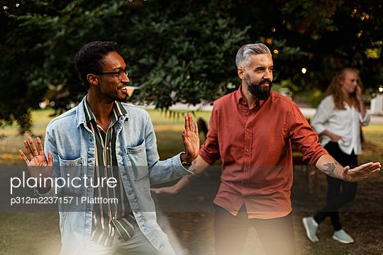 Male friends having fun in park - p312m2237157 by Plattform