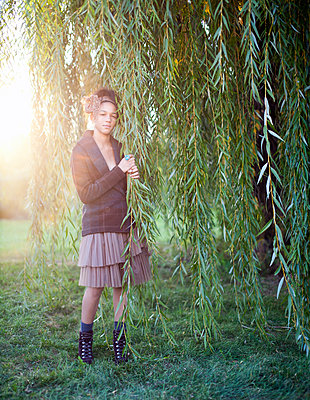 Portrait of stylish young teen holding Willow branch - p1614m2185781 by James Godman