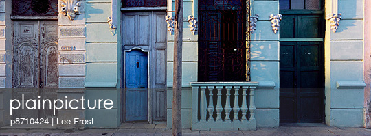 Facade of old colonial house in evening light, Cienfuegos, Cuba, West Indies, Central America