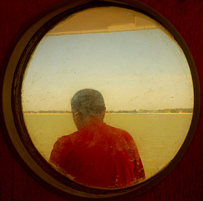 Man on a ferry - p567m822784 by Alexis Bastin