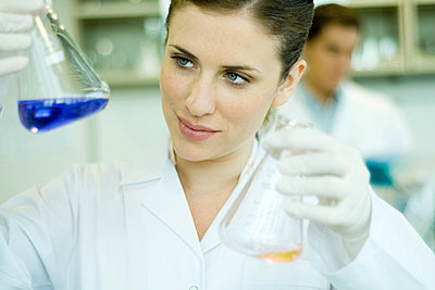 Young woman working in scientific laboratory - p62311076f by Eric Audras