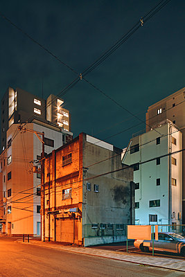 Night scene of old apartment block buildings, Osaka, Japan - p924m2164674 by Gu