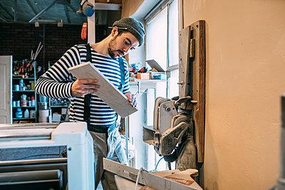 Carpenter at work on a grinder - p300m2121896 by Vasily Pindyurin