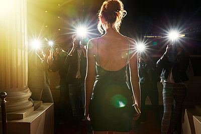 Silhouette of celebrity in black dress being photographed by paparazzi - p1023m1029966f by Sam Edwards