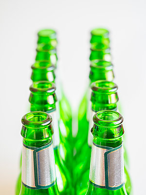 Ten empty green beer bottles in two rows - p1302m1573386 by Richard Nixon