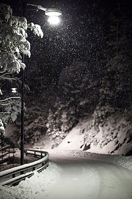 Winter road at night - p312m1164778 by Malcolm Hanes