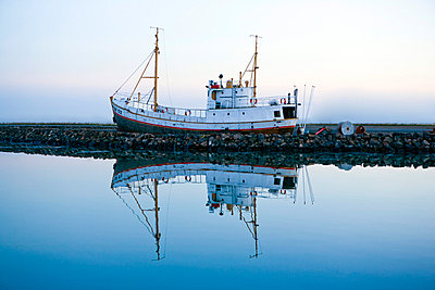 Fishing boat in harbour - p3883045 by Roussel