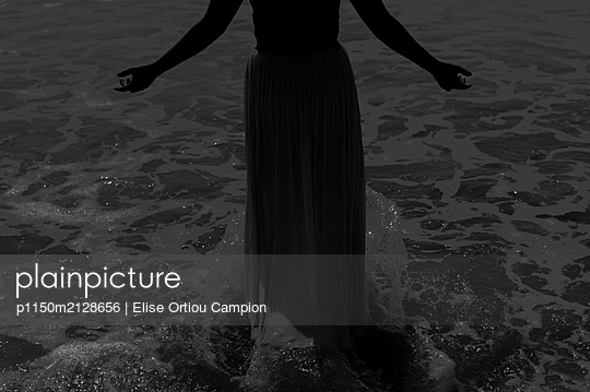 Woman in the sea - p1150m2128656 by Elise Ortiou Campion