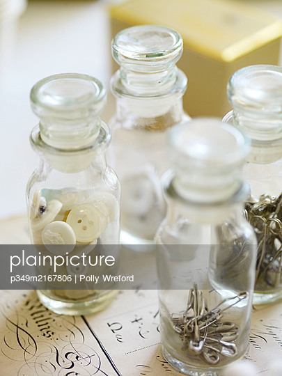 Antique vials with buttons and pins - p349m2167806 by Polly Wreford
